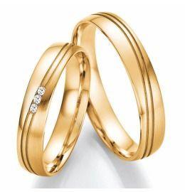 elegante auffalende Eheringe aus Gelbgold mit Brillanten